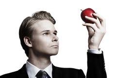 Biznesmen i jabłko Fotografia Royalty Free