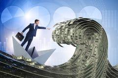 Biznesmen jazdy papieru łódź w dolarowym morzu obrazy stock