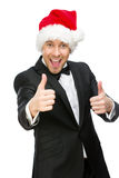 Biznesmen jest ubranym Święty Mikołaj nakrętki aprobaty Obrazy Royalty Free