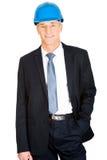 Biznesmen jest ubranym hełm z ręką w kieszeni Zdjęcie Stock