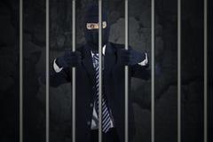 Biznesmen jest ubranym maskę w więzieniu Obrazy Stock