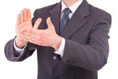 Biznesmen klascze jego ręki. Obraz Royalty Free