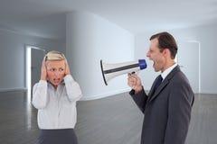 Biznesmen krzyczy przy kolegą z jego megafonem Zdjęcia Royalty Free