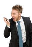Biznesmen krzyczy przy telefonem komórkowym Fotografia Stock