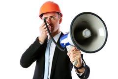 Biznesmen krzyczy z megafonem w hełmie zdjęcie royalty free