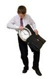 Biznesmen który kontroluje czas Fotografia Stock
