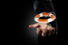 Biznesmen który trzyma lifebelt Pojęcie ubezpieczenie i pomoc w twój biznesie zdjęcia stock