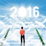 Biznesmen na schodkach z liczbami 2016 Zdjęcie Stock