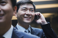 Biznesmen na telefonie, Pekin, indoors Obrazy Royalty Free