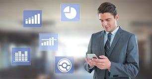 Biznesmen na telefonu i biznesowej mapy statystyki ikonach Zdjęcie Stock