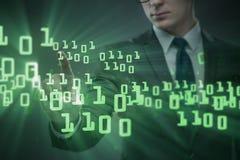 Biznesmen naciska binarnych guziki w techniki pojęciu Obraz Royalty Free