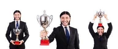 Biznesmen nagradzający z nagrodzoną filiżanką na bielu zdjęcia royalty free