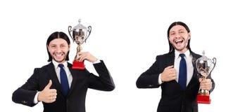 Biznesmen nagradzający z nagrodzoną filiżanką odizolowywającą na bielu fotografia royalty free
