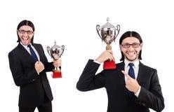 Biznesmen nagradzający z nagrodzoną filiżanką odizolowywającą na bielu obrazy stock