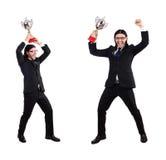Biznesmen nagradzający z nagrodzoną filiżanką odizolowywającą na bielu fotografia stock