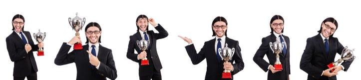 Biznesmen nagradzający z nagrodzoną filiżanką odizolowywającą na bielu obraz stock