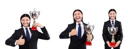 Biznesmen nagradzający z nagrodzoną filiżanką odizolowywającą na bielu zdjęcie royalty free