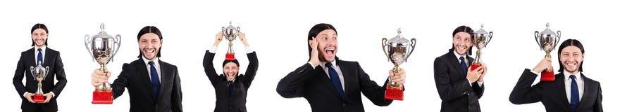 Biznesmen nagradzający z nagrodzoną filiżanką odizolowywającą na bielu zdjęcie stock