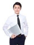 Biznesmen niesie z laptopem Zdjęcie Stock