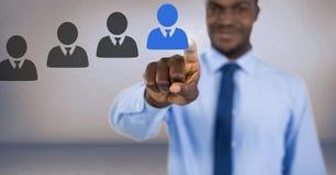 Biznesmen oddziała wzajemnie osoby i wybiera od grup ludzi ikon Obrazy Stock