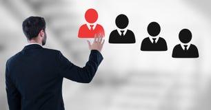 Biznesmen oddziała wzajemnie osoby i wybiera od grup ludzi ikon Obraz Stock