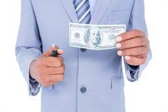 biznesmen pali dolarowego banknot Zdjęcie Royalty Free