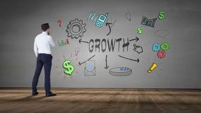 Biznesmen patrzeje ścianę z wzrostowym brainstorm zbiory