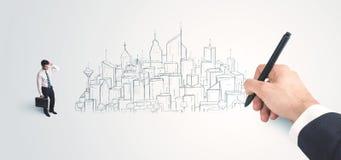 Biznesmen patrzeje gotowego rysującego miasto na ścianie Zdjęcie Royalty Free