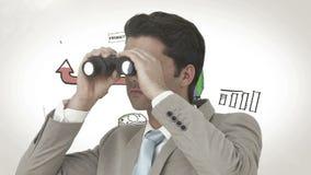 Biznesmen patrzeje przez lornetek przeciw brainstorm zbiory