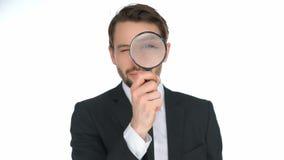 Biznesmen patrzeje przez powiększać - szkło zbiory