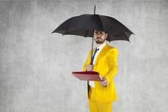 Biznesmen pod parasolem ochrania dane Zdjęcie Royalty Free