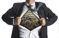 Biznesmen pokazuje bohatera kostium pod maszyneria metalem Obrazy Royalty Free
