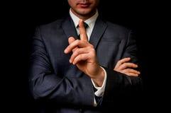 Biznesmen pokazuje jeden palec, robi cisza gestowi obrazy stock