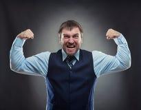 Biznesmen pokazuje jego mięśnie obraz stock