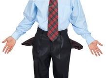 Biznesmen pokazuje jego pustą kieszeń, obraca jego kieszeniowy inside Obrazy Royalty Free
