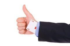 Biznesmen pokazuje ok znaka z as kartą pod rękawem. zdjęcia stock