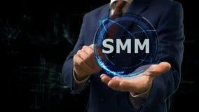 Biznesmen pokazuje pojęcie hologram SMM na jego ręce Obrazy Royalty Free