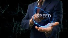Biznesmen pokazuje pojęcie holograma prędkość na jego ręce Obrazy Royalty Free