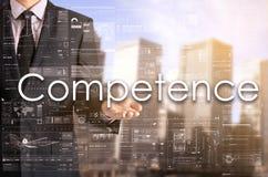 Biznesmen pokazuje tekst jego ręką: Kompetencja obraz stock