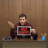biznesmen pomocy trzyma retro znaku chcieć Obrazy Stock
