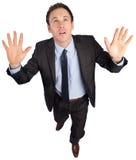 Biznesmen pozuje z rękami podnosić Obrazy Stock