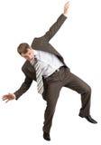 Biznesmen pozuje z rękami podnosić zdjęcia royalty free