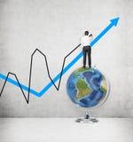 Biznesmen pozycja na kuli ziemskiej Obraz Stock