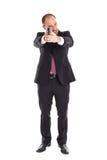 Biznesmen pozycja z pistoletem Zdjęcie Stock
