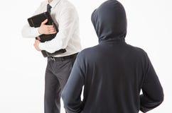 Biznesmen próbuje chować jego teczkę niewiadomym mężczyzna Zdjęcia Royalty Free