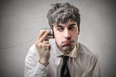 Biznesmen próbuje słuchać coś Obraz Stock