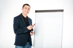 Biznesmen przedstawia coś na whiteboard Obrazy Royalty Free