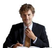 Biznesmen przystosowywa jego krawata ono uśmiecha się zdjęcia royalty free