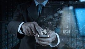 Biznesmen ręka używać telefon komórkowego z cyfrowym warstwa skutkiem jak Fotografia Royalty Free