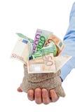 Biznesmen ręka z torbą pełno euro banknoty Obrazy Royalty Free
